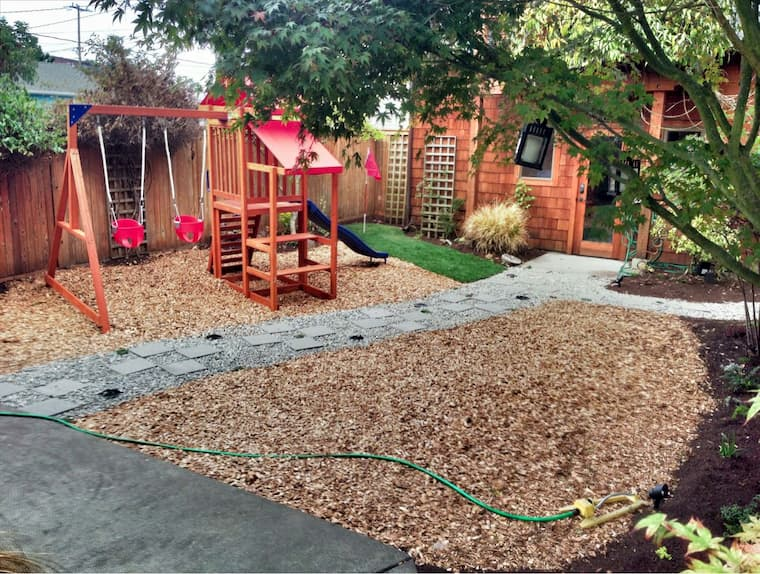 yard with wood chips and kids playground