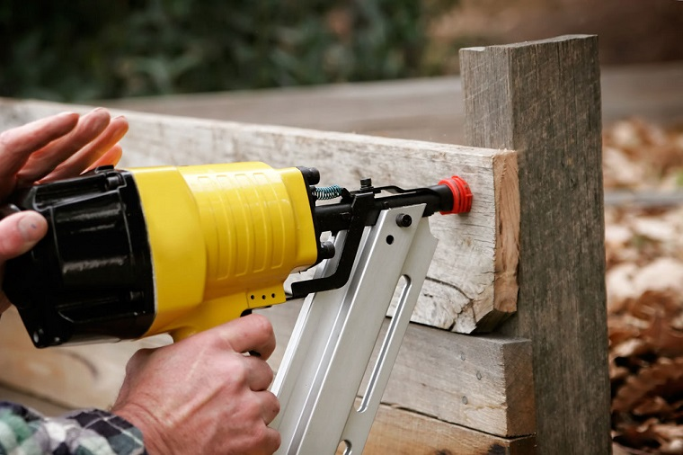 Framing nail gun with protective guards