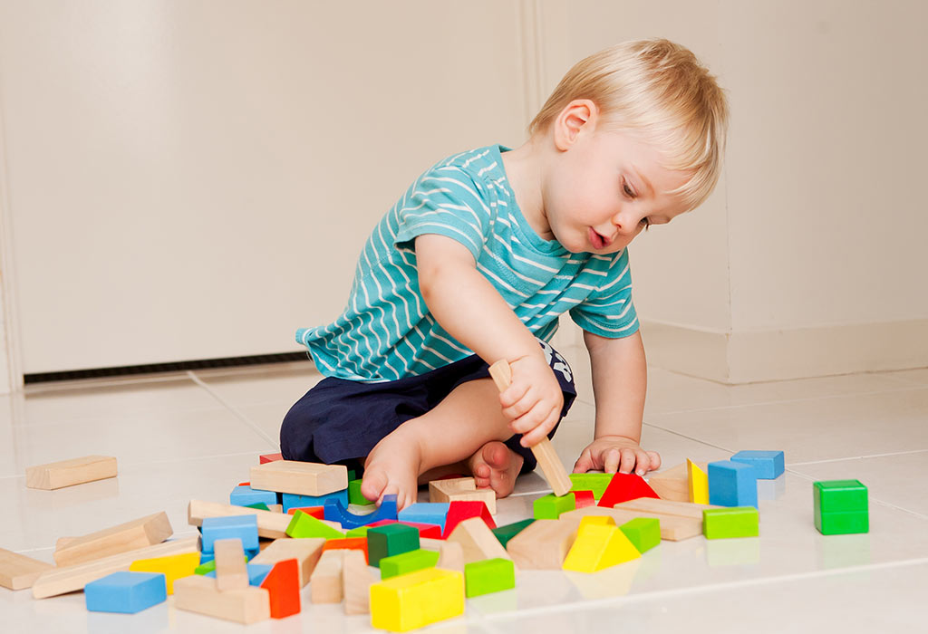baby-playing-with-toys-early-development