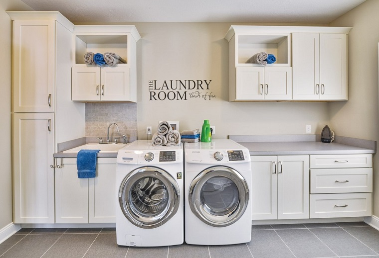 picture of a laundry room with full equipment and spacious cabinets