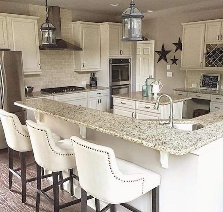 White kitchen with bar stools with arm rest