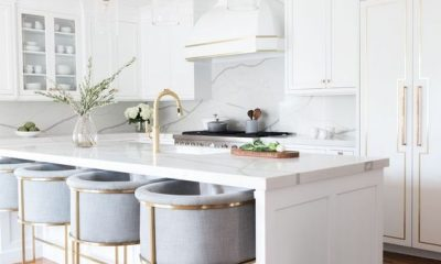 beautiful white kitchen and kitchen island with grey high bar stools