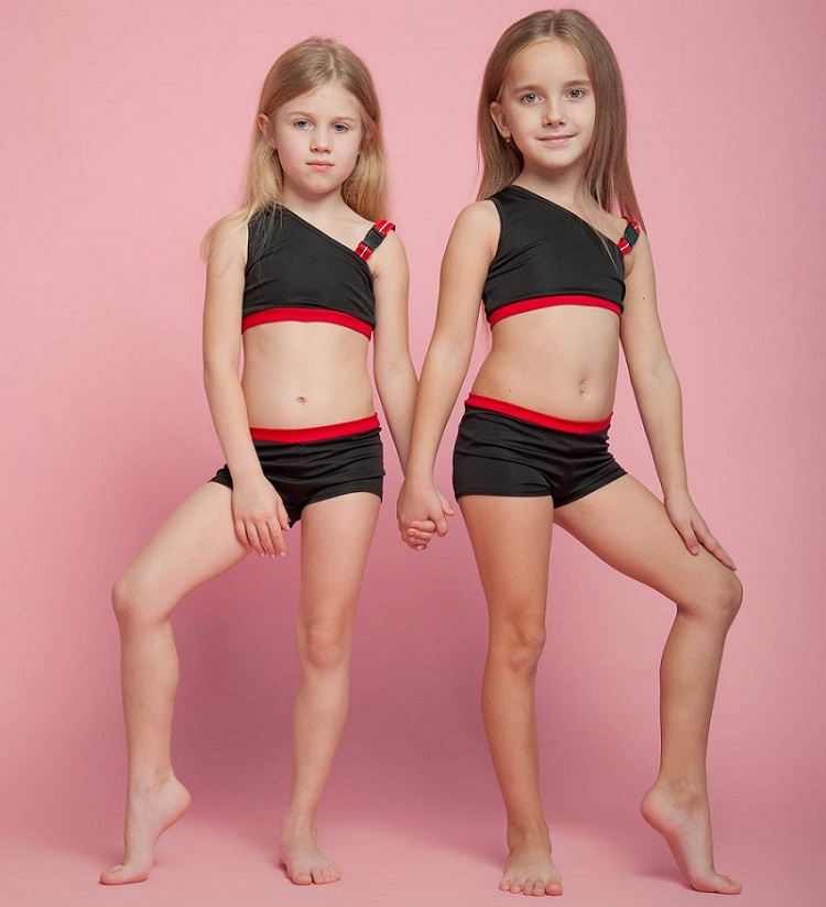 picture of two little girls wearing leotards and shorts for dancing