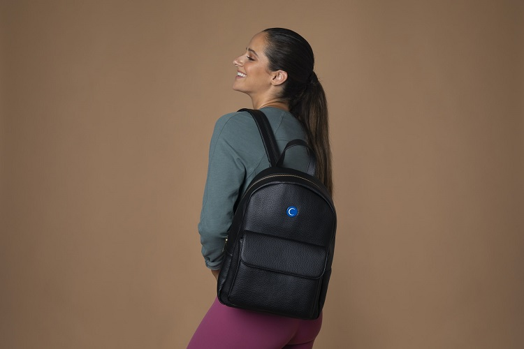 picture of a woman wearing sports clothes and a black bag