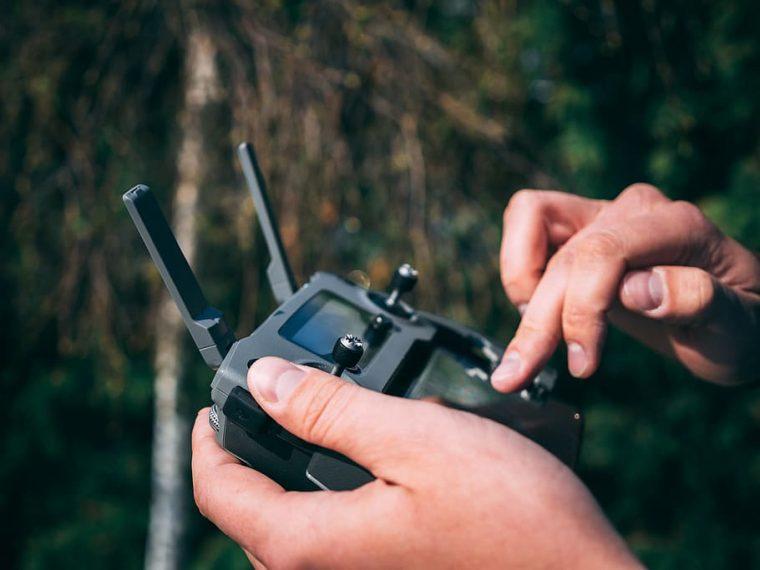 person-holding-drone-remote-controller
