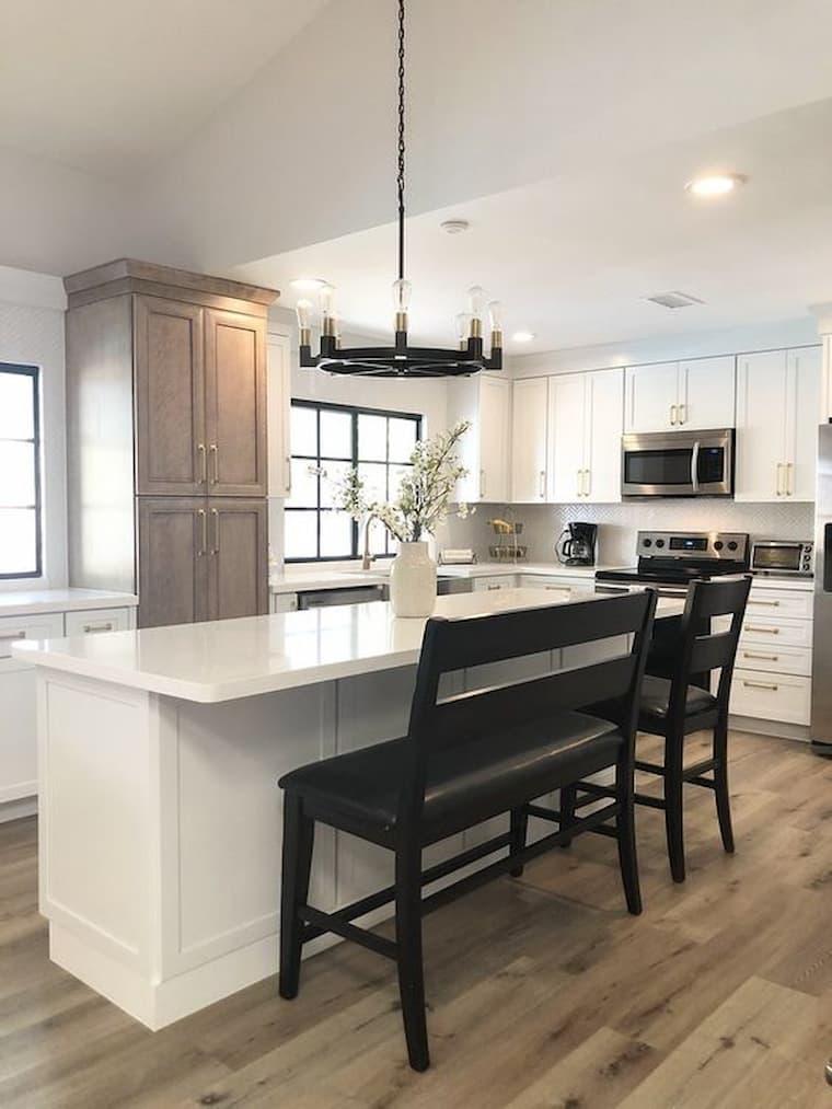 white kitchen with kitchen island and beautiful vinyl flooring
