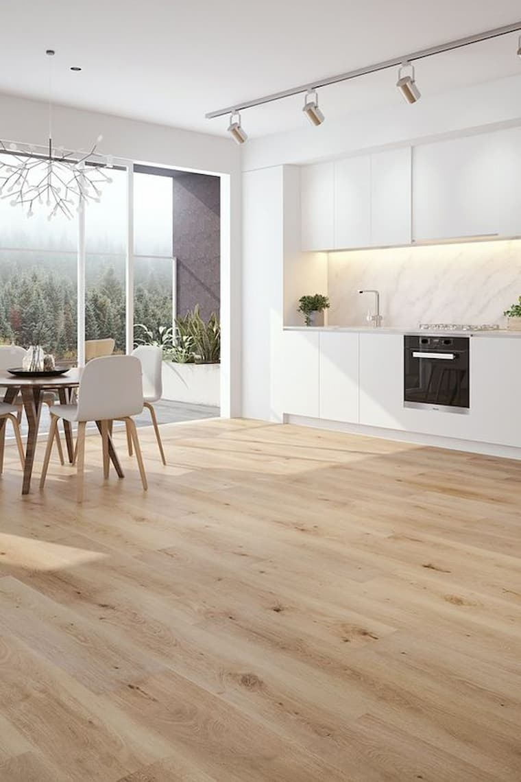 beautiful white kitchen with light wood vinyl flooring