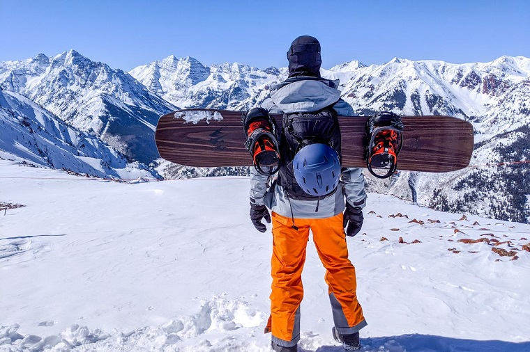 Snowboarder with snowboarding equipment